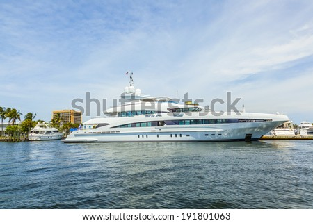 FORT LAUDERDALE, USA - AUG 1: big yacht at waterfront homes on Aug 1, 2010 in Fort Lauderdale. There are 165 miles  of waterways within the city limits and 9,8 percent of the city is covered by water. - stock photo