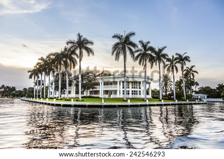 FORT LAUDERDALE, USA - AUG 20, 2014: Luxurious waterfront home in Fort Lauderdale, USA. There are 165 miles of waterways within the city limits and 9,8 percent of the city is covered by water. - stock photo