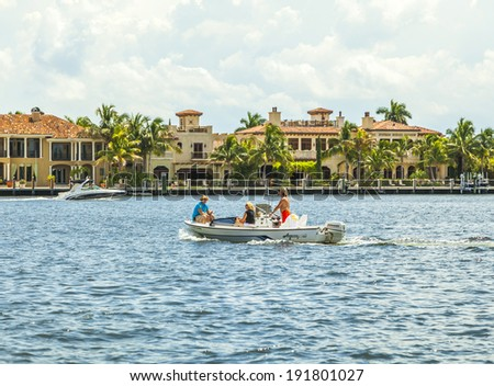 FORT LAUDERDALE, USA - AUG 1: people in motor boat on Aug 1, 2010 in Fort Lauderdale. There are 165 miles  of waterways within the city limits and 9,8 percent of the city is covered by water. - stock photo