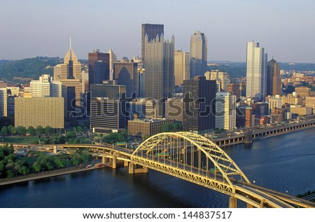 Fort Pitt Bridge over Monongahela River at sunset with Pittsburgh skyline, PA - stock photo