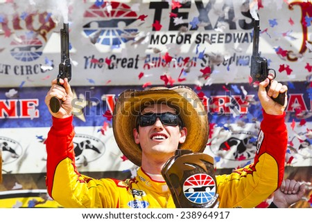 "Fort Worth, TX - Apr 07, 2014: Joey Lagano (22) wins the ""Duck Commander 500"" at Texas Motor Speedway in Fort Worth, TX. - stock photo"