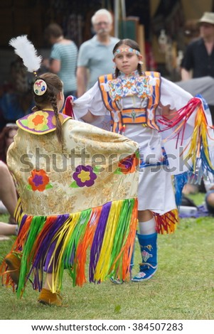 Fort York, Toronto - July 25, 2015 - Native American performers dancing at a pow-wow dressed in their traditional costumes representing their tribes. - stock photo