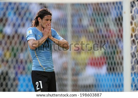 FORTALEZA, BRAZIL - June 14, 2014: Cavani of Uruguay after scoring a penalty goal during the 2014 World Cup Group D game between Uruguay and Costa Rica at Castelao Stadium. No Use in Brazil. - stock photo