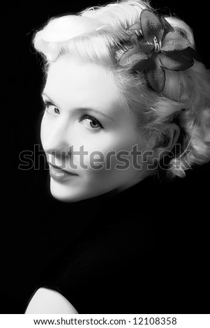 Forties hollywood black and white a beautiful woman stares back. Minimal lighting and strong contrast copy - stock photo