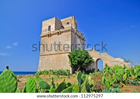 Fortified tower in Punta Colimena. Apulia. Italy. - stock photo