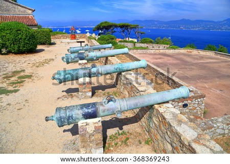Fortified walls guarded by medieval canons of Saint Tropez fortress, French Riviera, France - stock photo