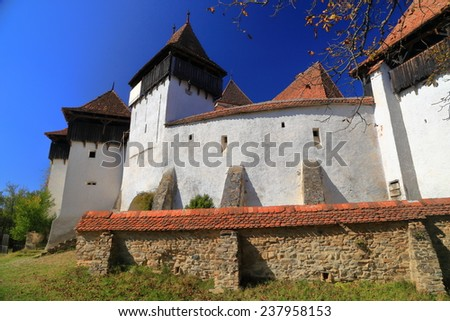 Fortified walls of medieval church from UNESCO world heritage list in Viscri village, Transylvania, Romania - stock photo
