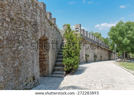 Fortress on a cliff in San Marino - stock photo