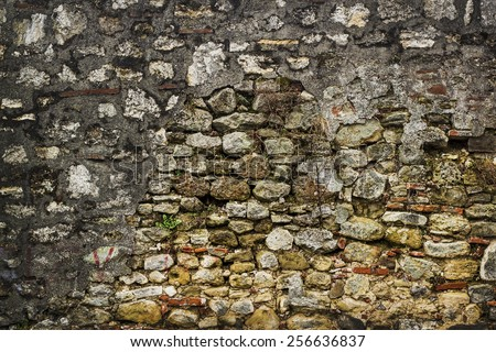 Fortress stone wall texture - stock photo