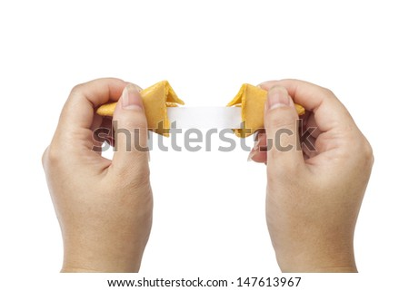 fortune cookie held open to blank fortune - stock photo