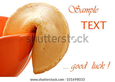 Fortune cookie with orange dessert dish on white background with copy space.  Macro with shallow dof. - stock photo