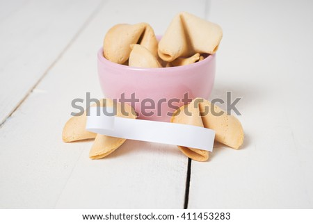 Fortune cookies on the white wood  background - stock photo
