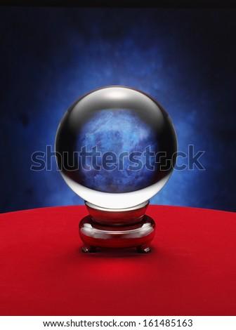 fortune teller crystal ball on red desk - stock photo