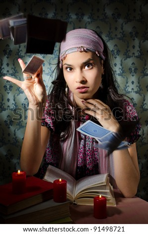 Fortune teller is throwing the cards - stock photo