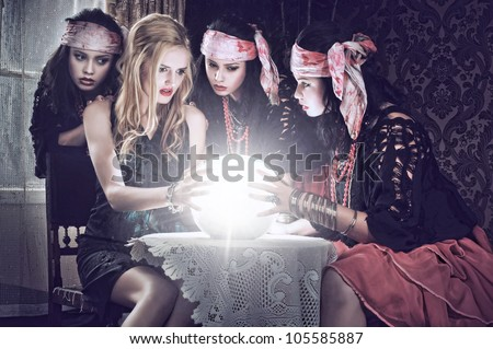 fortune teller with her crystal ball. Illusion - stock photo