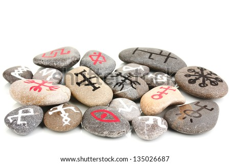 Fortune telling  with symbols on stones isolated on white - stock photo