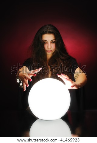 Fortuneteller with magic sphere - stock photo