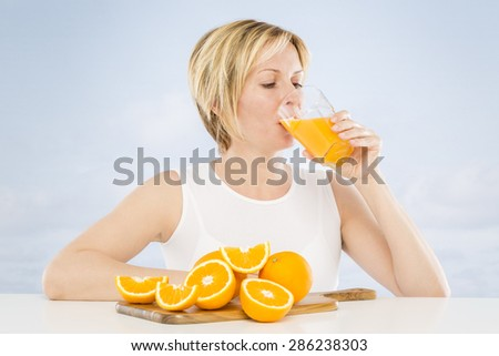 Forty years woman drinking juice - stock photo