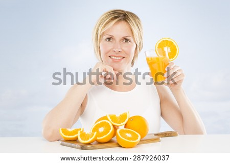 Forty years woman recommends orange juice - stock photo