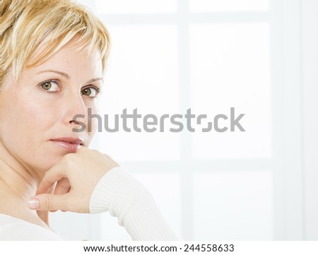 Forty years woman with short blonde hair - stock photo