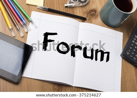 Forum - Note Pad With Text On Wooden Table - with office  tools - stock photo