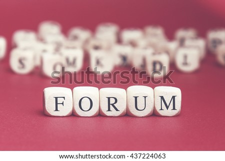 Forum word written on wood cube with red background - stock photo