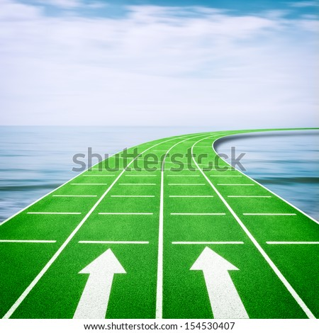 Forward concept with arrows on running track in ocean - stock photo