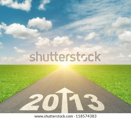 Forward to 2013 concept with road, arrow and date - stock photo