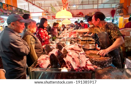 FOSHAN - April 13:The meat market of agricultural products is very rich, Chinese after years of development, has solved the problem of food and clothing of the people April 13, 2013 in Foshan, China - stock photo