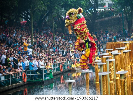 FOSHAN, CHINA - MAY 1: 18 from around the China lion dance team came to the town of Xiqiao in 2 days of water lion championship, competition attracted many people to watch May 1, 2014 in Foshan, China - stock photo