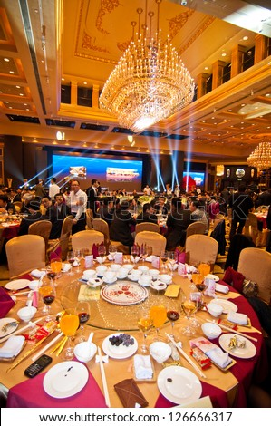 FOSHAN CITY-JANUARY 20: Foshan city hall held to celebrate Chinese New Year dinner at the hotel in 2013, more than 1000 of the industry people attended the banquet January 20, 2012 in Foshan, China - stock photo
