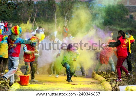 FOSHAN - Dec 28: color running activities held in the outskirts of the park, there are 200 fans in 5 kilometers each throw maize flour, happy through a Sunday, Dec 28, 2014 in FOSHAN, China - stock photo