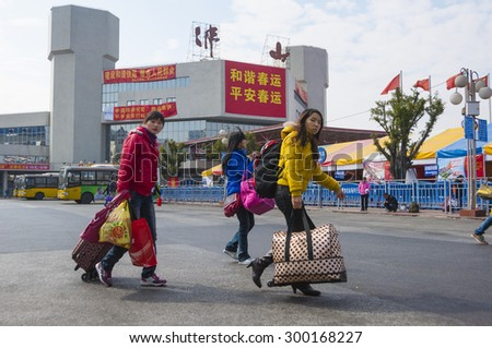 FOSHAN-Jan 30:The Spring Festival is coming, labor with luggage ready to take the train back to hometown festival, Chinese  have a custom of home for the Spring Festival Jan 30, 2011 in Foshan, China - stock photo