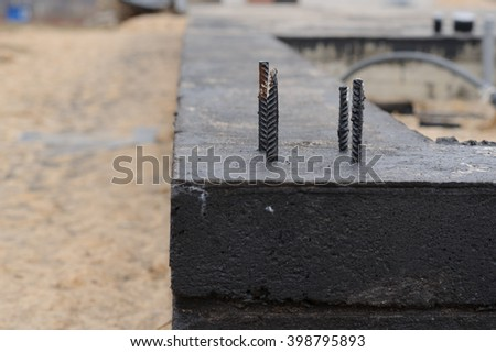 Foundation building. Pouring a concrete slab formwork along the foundation. - stock photo