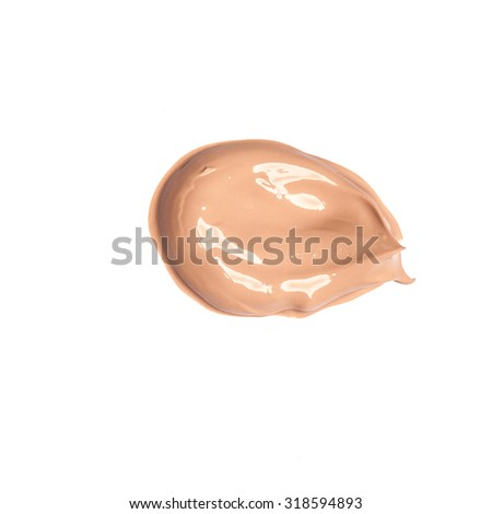 Foundation color sample smeared on white background - stock photo
