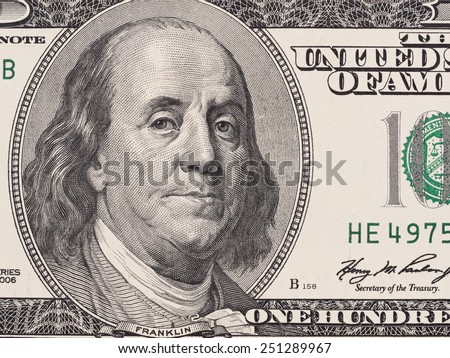 Founding father Benjamin Franklin portrait closeup on US 100 dollar bill, united states money - stock photo