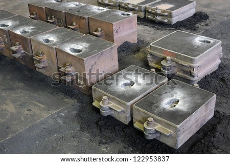 Foundry, sand molded casting, molding flasks - stock photo