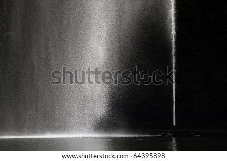 Fountain against dark background - stock photo
