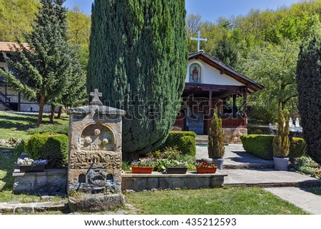 Fountain and church in Temski monastery St. George, Pirot Region, Republic of Serbia - stock photo