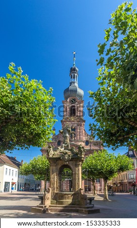 Fountain and Church of St. Alexander in Rastatt - Baden-Wurttemberg, Germany - stock photo