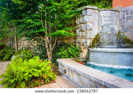 Fountain and garden at Piedmont Park in Atlanta, Georgia. - stock photo