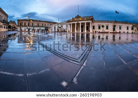 Fountain and Saint George Square on the Rainy Morning, Valletta, Malta - stock photo