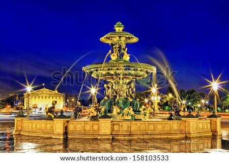 Fountain at Place de la Concord in Paris  by dusk. France. - stock photo