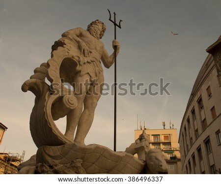 Fountain at Verdi Square, a statue of Poseidon with a trident, Trieste Italy - stock photo