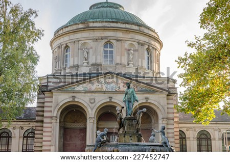 Fountain in front of old domed building - stock photo