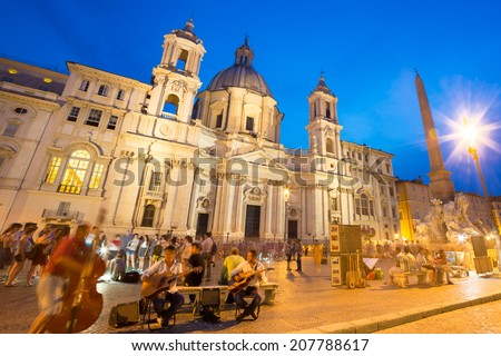 Fountain of the four Rivers and SantAgnese in Agone on Navona square in Rome, Italy, Europe shot at dusk. - stock photo