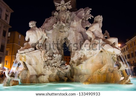 Fountain of the Four Rivers in Piazza Navona, Rome, Italy./Rome at night - stock photo