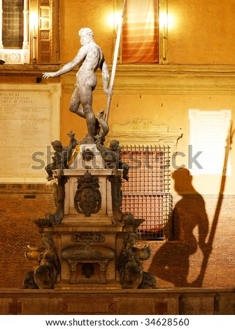 Fountain on Piazza Maggiore at night in Bologna, Italy - stock photo
