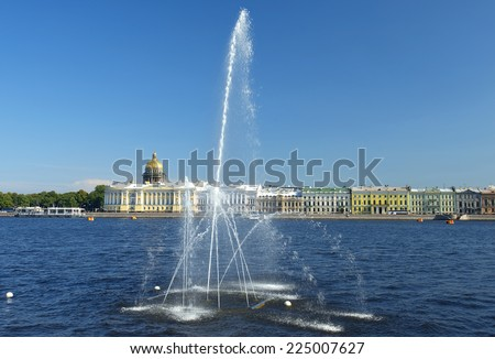 fountain on the Neva River at the background of historical buildings of Saint Petersburg - stock photo