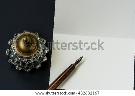 Fountain pen, inkwell, letter - stock photo